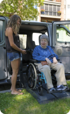 caregiver and teen woman smiling