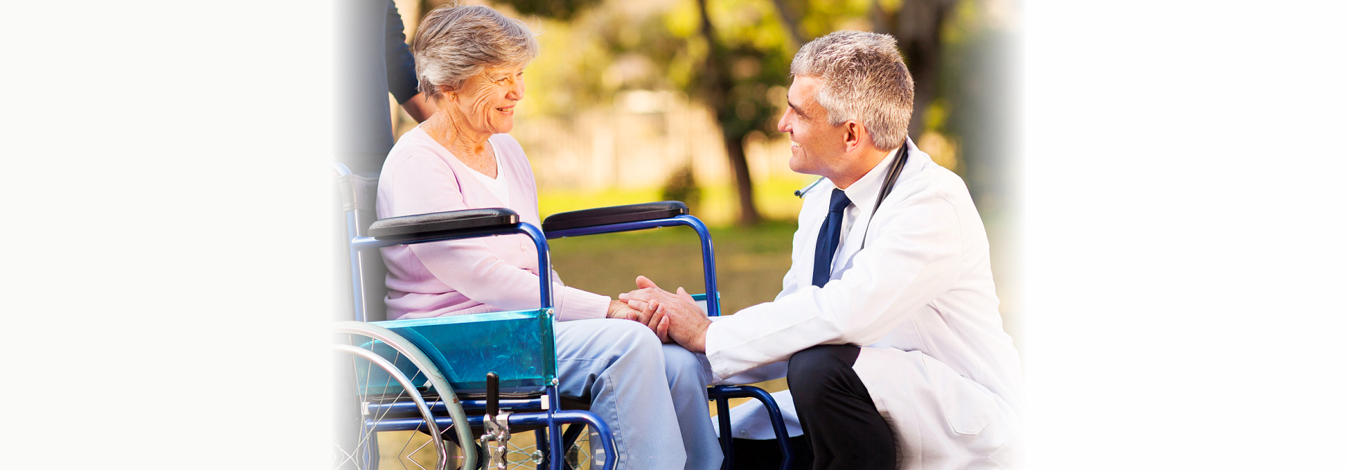 doctor comforting old woman