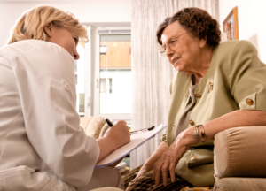 caregiver talking to the senior woman